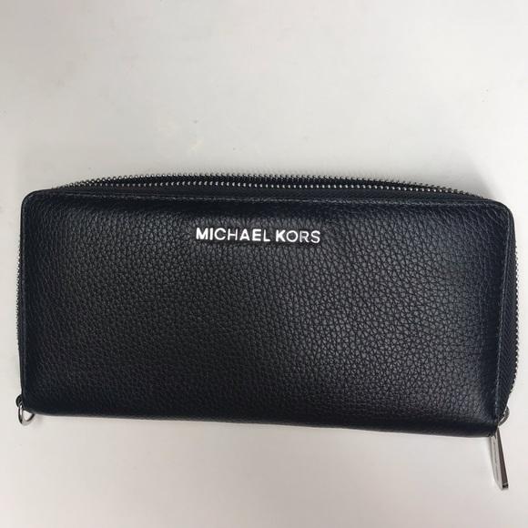 Michael Kors Handbags - Michael Kors black zip up wallet
